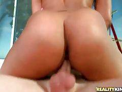 Booty black slutie is passionately jumping on lover`s boner.