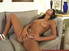 Sandy Rio is naked on the couch, squeezing her tiny titties and fingering her slippery hole!